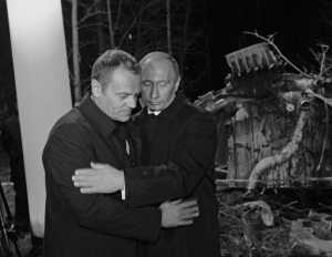 Russia's PM Putin comforts his Polish counterpart Tusk as they visit the site of a Polish government Tupolev Tu-154 aircraft crash near Smolensk airport